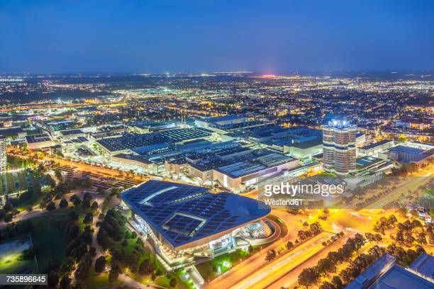 Germany, Bavaria, Munich, cityscape with BMW Headquarter near Olympic Park at night, drone photography