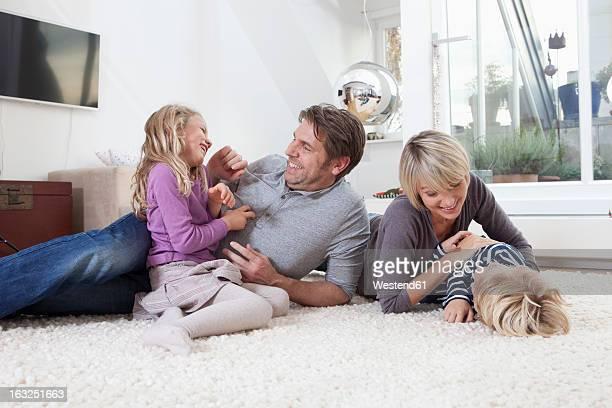 Germany, Bavaria, Munich, Family having fun on floor