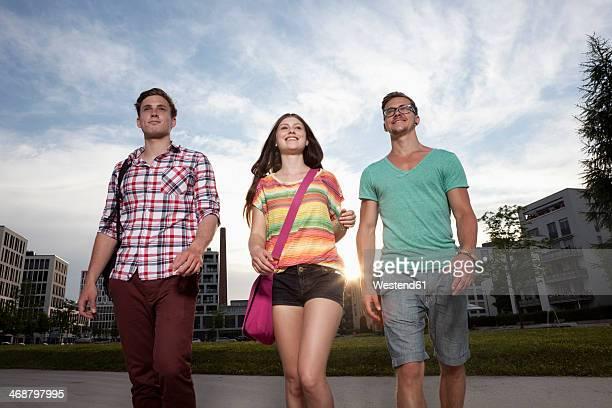 Germany, Bavaria, Munich, Friends walking in city