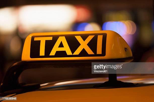 Germany, Bavaria, Munich, Illuminated sign on taxi showing availability