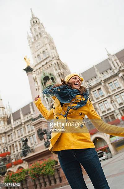 germany, bavaria, munich, marienplatz, portrait of a woman, town hall in background - marienplatz stock pictures, royalty-free photos & images