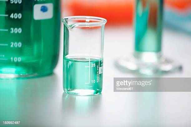 Germany, Bavaria, Munich, Measuring beaker with green liquid for medical research