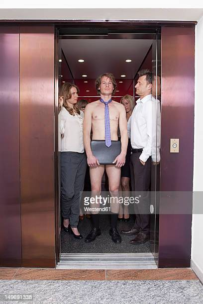 Germany, Bavaria, Munich, Men and women standing in elevator