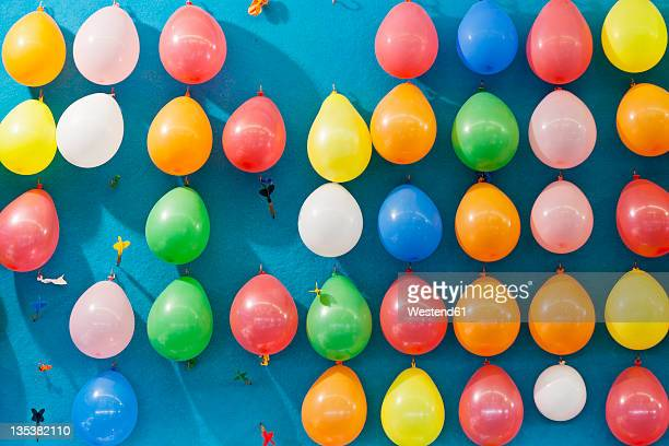 germany, bavaria, munich, multi coloured balloons and dart at oktoberfest - special:random stock pictures, royalty-free photos & images