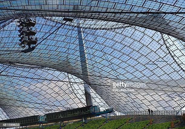 Germany, Bavaria, Munich, Olympic Stadium built as the main venue for the 1972 Summer Olympics. View along seating beneath large sweeping canopies of...