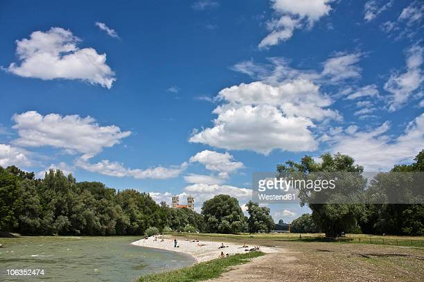 germany, bavaria, munich, people at river isar with st. maximilian church in background - fiume isar foto e immagini stock
