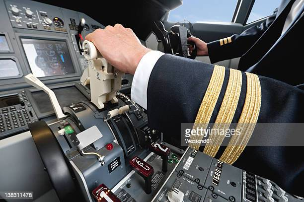 Germany, Bavaria, Munich, Pilot piloting aeroplane from airplane cockpit