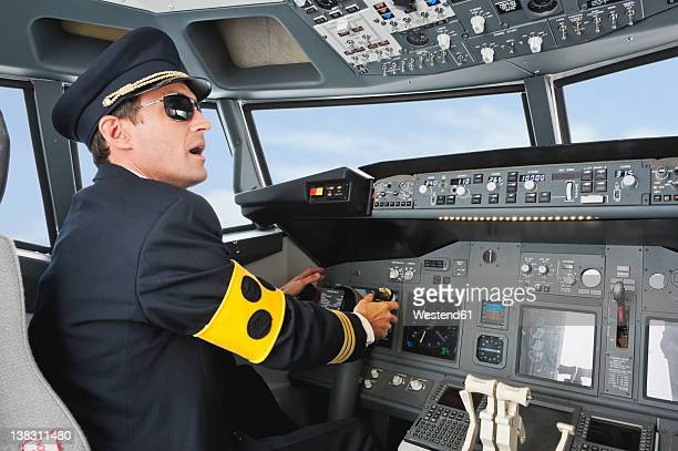 germany, bavaria, munich, pilot with armlet for blind piloting aeroplane from airplane cockpit - uniform cap stock pictures, royalty-free photos & images