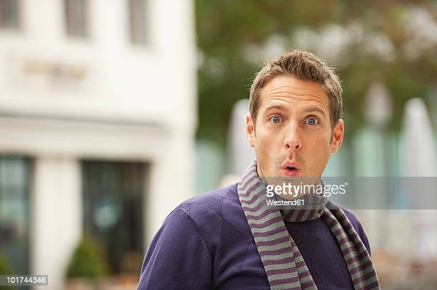 Germany, Bavaria, Munich, Surprised man, portrait
