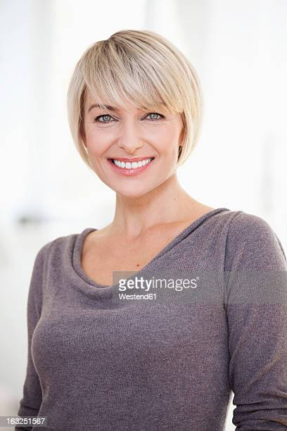 Germany, Bavaria, Munich, Portrait of woman, smiling