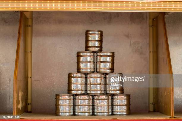 Germany, Bavaria, Munich, pyramid of tin cans in fairground booth at Oktoberfest