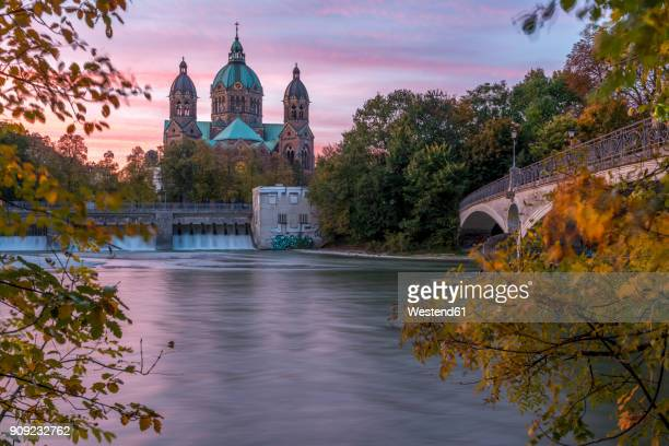 germany, bavaria, munich, river isar, prater island and st luke's church in autumn - munich stock pictures, royalty-free photos & images