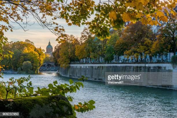 germany, bavaria, munich, river isar, prater island and st luke's church in autumn - fiume isar foto e immagini stock