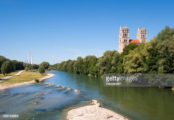 Germany, Bavaria, Munich, river Isar with Fruehlingsanlagen, church St. Maximilian and cogeneration plant in background