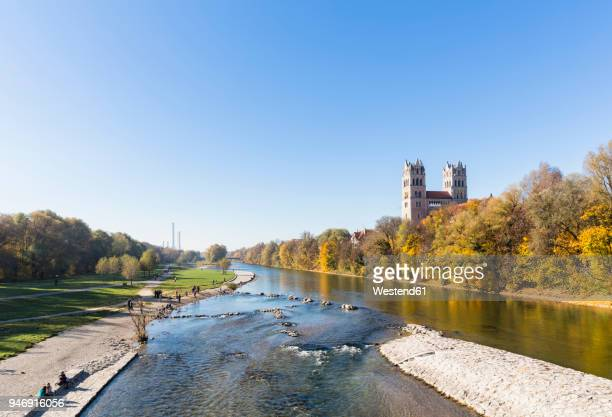 germany, bavaria, munich, river isar with fruehlingsanlagen, church st. maximilian and cogeneration plant in background - fiume isar foto e immagini stock