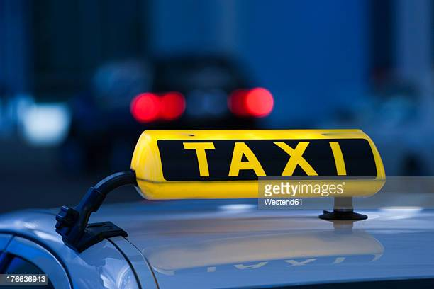 Germany, Bavaria, Munich, Roof of taxi and taxi sign