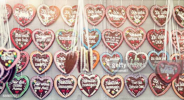 Germany, Bavaria, Munich, rows of gingerbread hearts at Oktoberfest