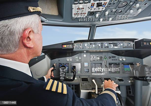 Germany, Bavaria, Munich, Senior flight captain piloting aeroplane from airplane cockpit