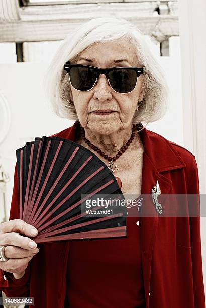 germany, bavaria, munich, senior woman with folding fan, portrait - hand fan stock pictures, royalty-free photos & images
