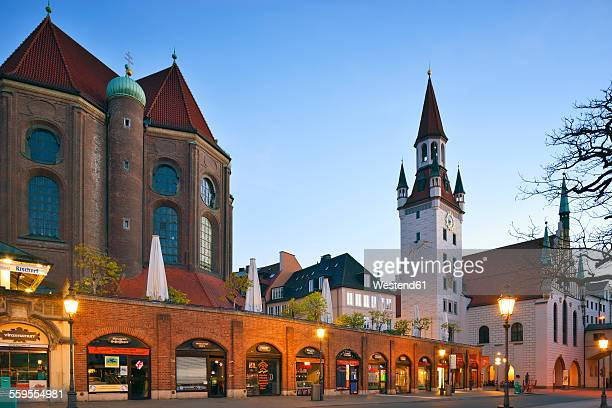 Germany, Bavaria, Munich, View from Viktualienmarkt to Church St. Peter, old town hall tower in the evening