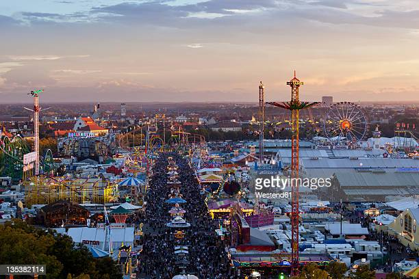 germany, bavaria, munich, view of oktoberfest fair at dusk - oktoberfest stock pictures, royalty-free photos & images