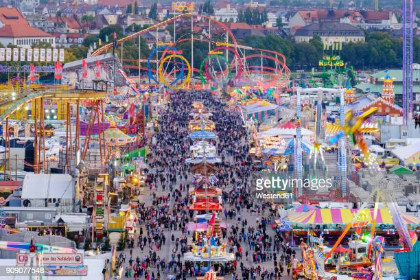 germany, bavaria, munich, view of oktoberfest fair on theresienwiese in the evening - theresienwiese stock pictures, royalty-free photos & images