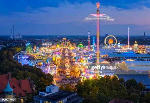 germany, bavaria, munich, view of oktoberfest fair on theresienwiese in the evening - high contrast stock pictures, royalty-free photos & images