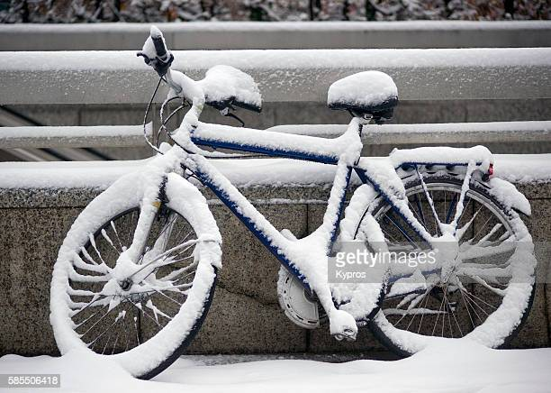 Germany, Bavaria, Munich, View Of Snow Covered Bicycle
