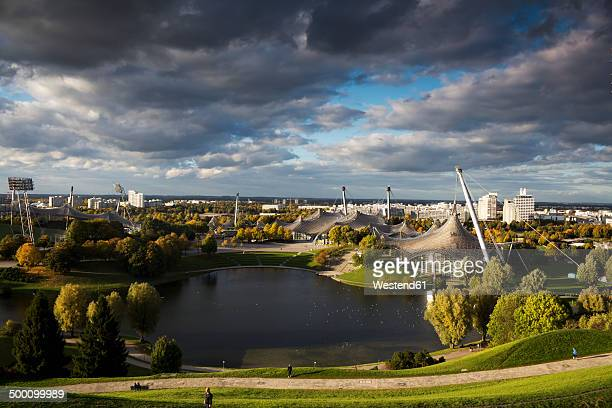 germany, bavaria, munich, view to olympic park, olympic lake - olympiastadion munich stock pictures, royalty-free photos & images