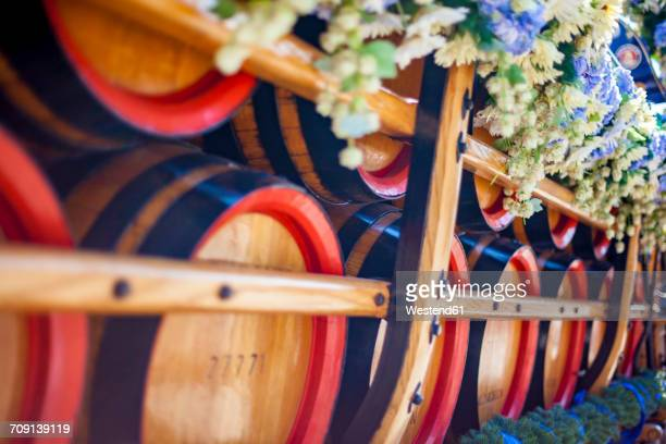 Germany, Bavaria, Munich, wooden barrels on cart at Oktoberfest
