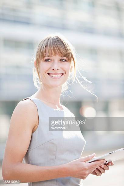 Germany, Bavaria, Munich, Young businesswoman with digital tablet