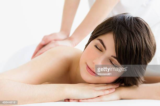 Germany, Bavaria, Munich, Young woman getting massage from man, close up