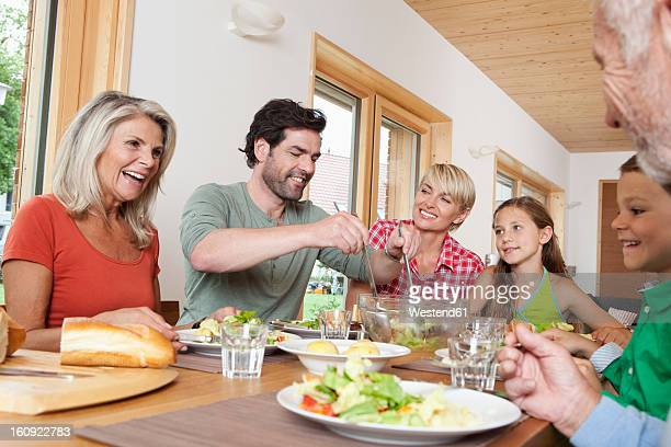 Germany, Bavaria, Nuremberg, Family having lunch together
