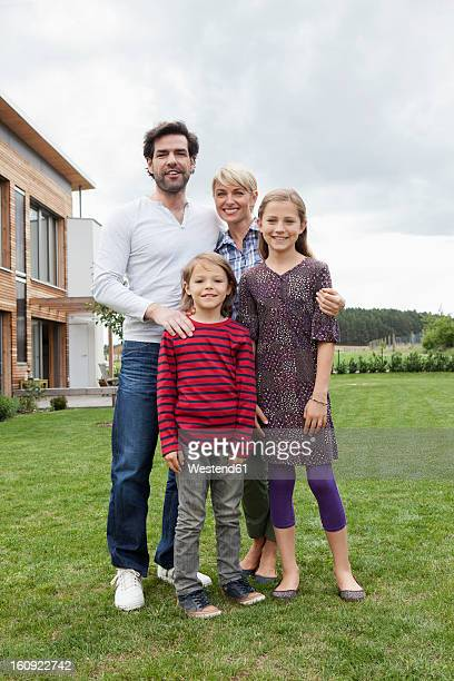 Germany, Bavaria, Nuremberg, Portrait of family in front of house
