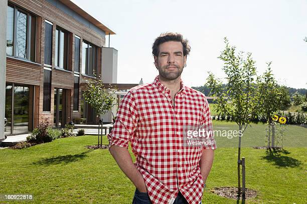 Germany, Bavaria, Nuremberg, Portrait of mature man in garden