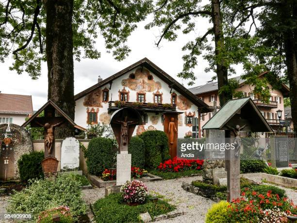 Oberramergau Welldecorated graves in the cemetery of the town which is famous for its houses' painted facades sometimes in trompe l'oeil