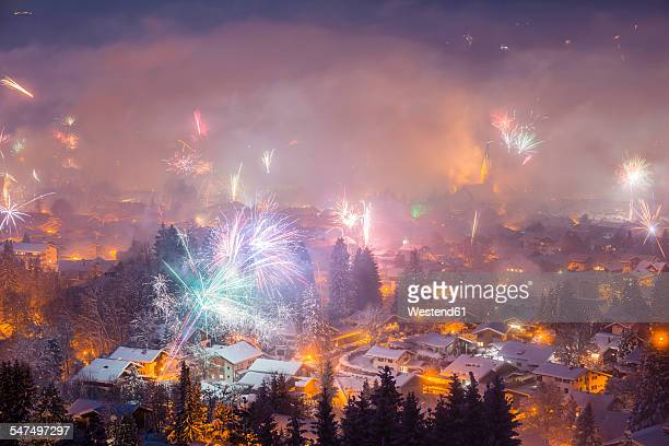 Germany, Bavaria, Oberstdorf, Fireworks at New Years Eve