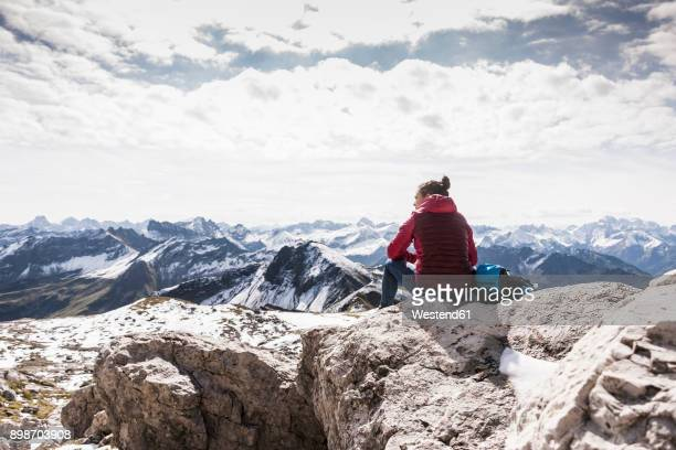 Germany, Bavaria, Oberstdorf, hiker sitting in alpine scenery