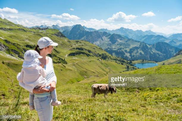 Germany, Bavaria, Oberstdorf, mother and little daughter on a hike in the mountains