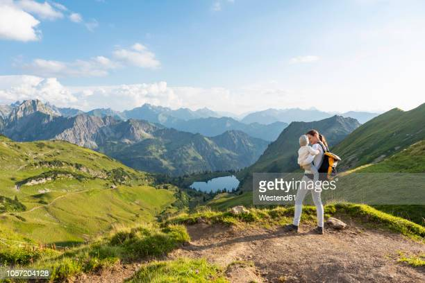 germany, bavaria, oberstdorf, mother and little daughter on a hike in the mountains - observation point stock pictures, royalty-free photos & images