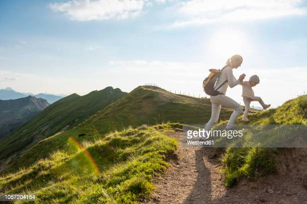germany, bavaria, oberstdorf, mother and little daughter on a hiking trip in the mountains - oberstdorf stock pictures, royalty-free photos & images