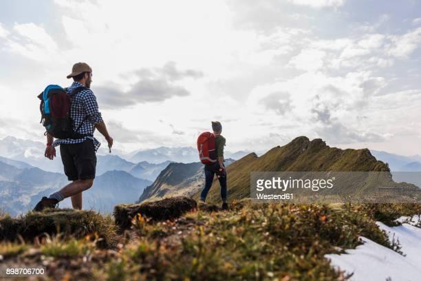Germany, Bavaria, Oberstdorf, two hikers walking on mountain ridge