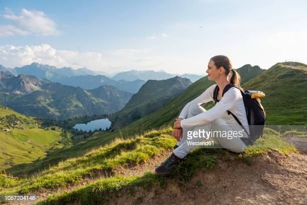 germany, bavaria, oberstdorf, woman on a hike in the mountains having a break - oberstdorf stock pictures, royalty-free photos & images