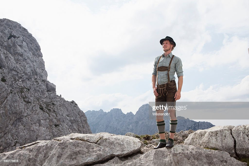 Germany, Bavaria, Osterfelderkopf, man in traditional clothes standing in mountain landscape : Photo