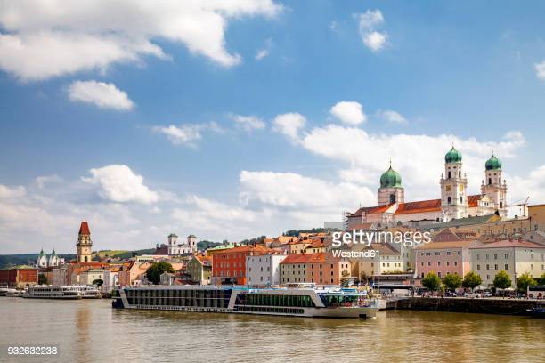 Germany, Bavaria, Passau, Old town and Inn river with tourboat
