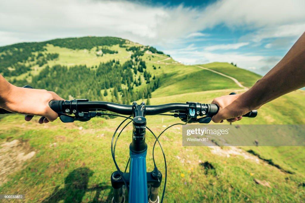 Germany, Bavaria, Pfronten, mountainbiker riding downhill on alpine meadow near Aggenstein : Stock Photo