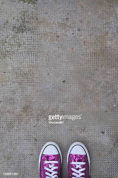 Germany, Bavaria, Pink shoes on concrete floor