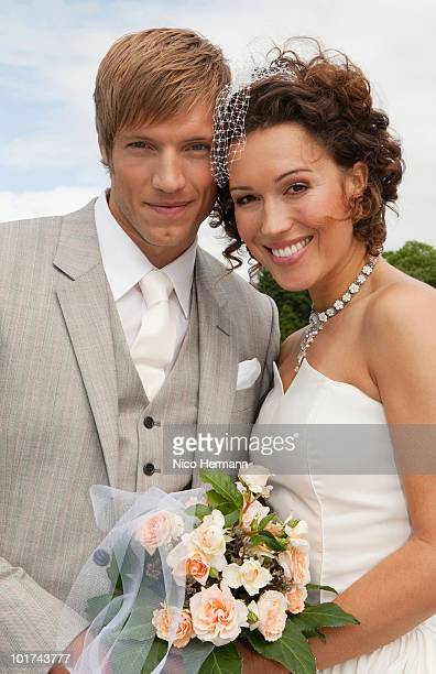 germany, bavaria, portrait of groom and bride, outdoors, close-up - europa occidental fotografías e imágenes de stock