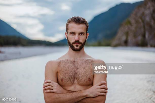 germany, bavaria, portrait of shirtless young man in nature - halbbekleidet stock-fotos und bilder
