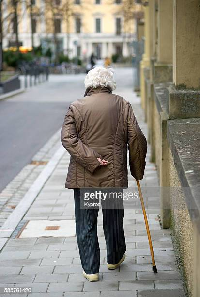 Germany, Bavaria, Regensburg, View Of Elderly Woman With Walking Stick
